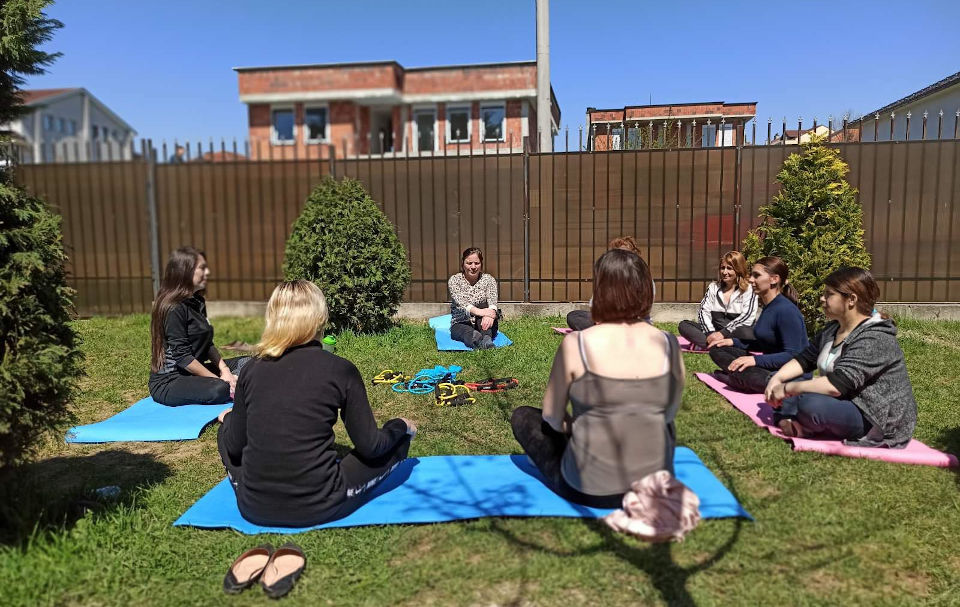 Survivors of domestic violence practice yoga to help them cope with the psychological consequences of the violence. Photo: Erblina Dinarama, Safe House