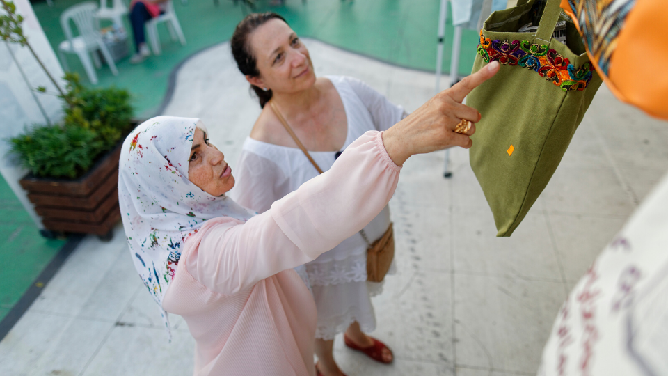 Safiye Mustafa (on the left) is one of the Syrian members of the Cooperative. Photo: Tayfun Dalkilic