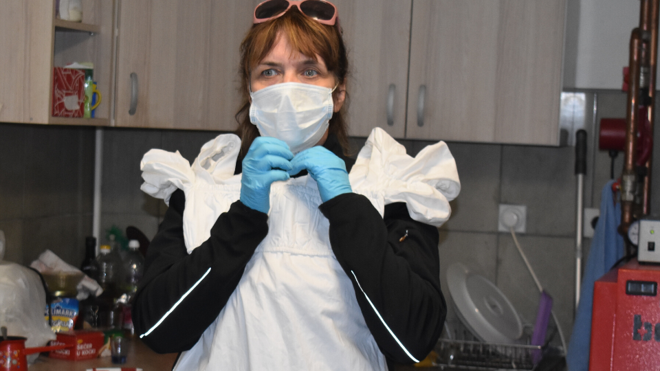 With full personal protective equipment, Snezana Zivadinovic travelled during COVID-19 pandemic to numerous villages in central Serbia advocating for an equal distribution of care and domestic work. Photo courtesy of Society for the Development of Creativity
