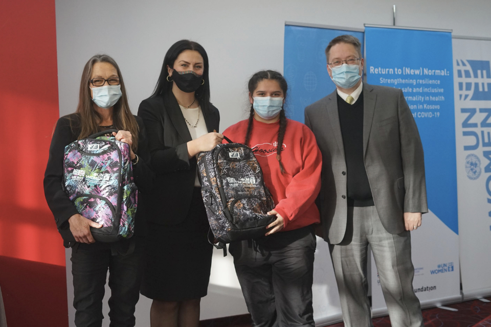 British Ambassador to Kosovo, Nicholas Abbott; UN Development Coordinator, Ulrika Richardson, and UN Women Head of Office, Vlora Tuzi Nushi, pictured with a young woman from Roma, Ashkali and Egyptian communities who received a laptop to facilitate her online learning. Photo: UN Women