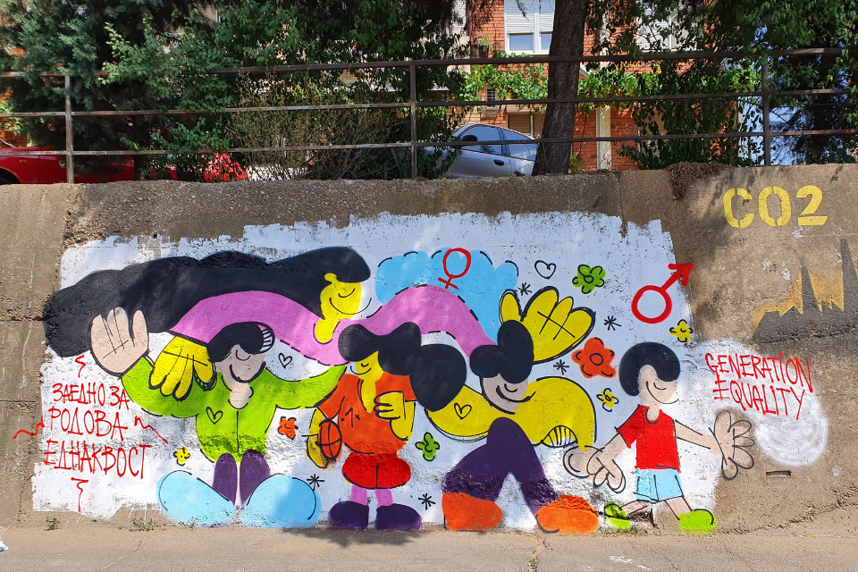 """The mural """"Together for Gender Equality"""" in North Macedonia. The mural artist Goran Kostovski – Indog painting the first mural """"Equality,"""" for the initiative, before it was damaged. Photo: UN Women/Mirjana Nedeva"""