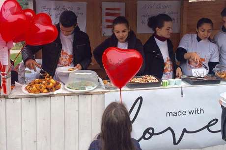 Members of the Made with Love team sell baked goods made by survivors of violence. UN Women/Ina Cenko