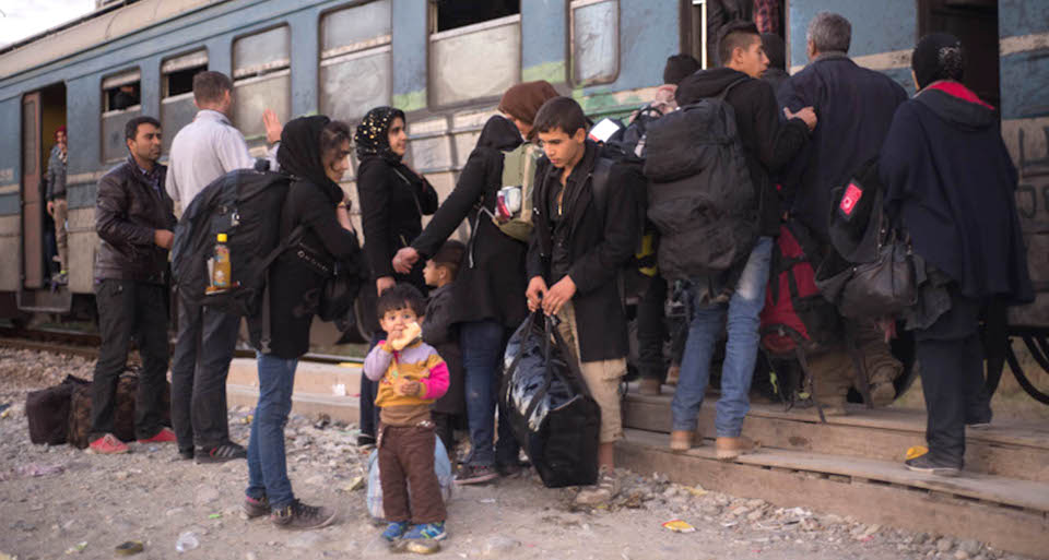 Refugees getting ready for the train in Gevgelija to travel to the border with Serbia.