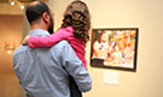 """Part the of the photo exhibit entitled """"Because I am a Father: Egyptian and Swedish Dads"""" featuring photos from Egypt and Sweden, portraying the universal role of fatherhood."""