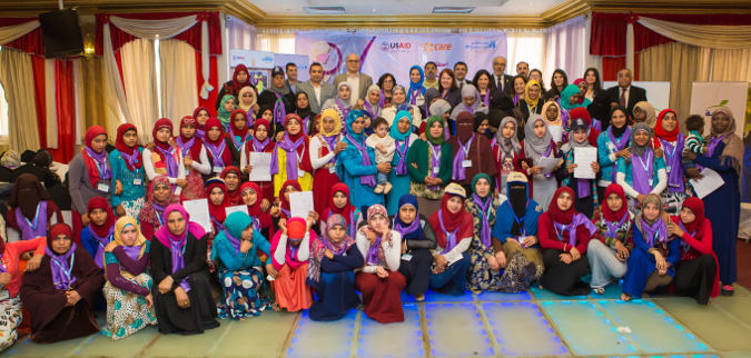 Women and girls who participated in Women's Empowerment Promotion Programme pose for a picture with key partners from UN Women, USAID, and CARE