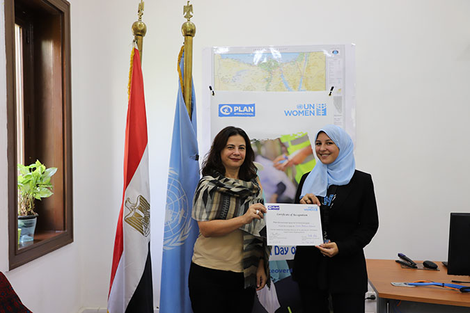 Blerta Aliko, UN Women Country Representative handing over a certificate to Omneya who took over her place for the day