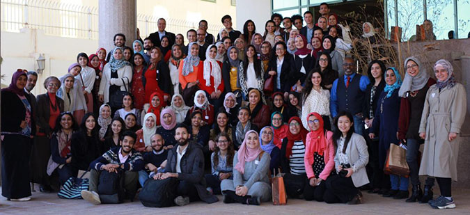 "a group photo during ""Her Story"" event in celebration of Internation Women's Day"