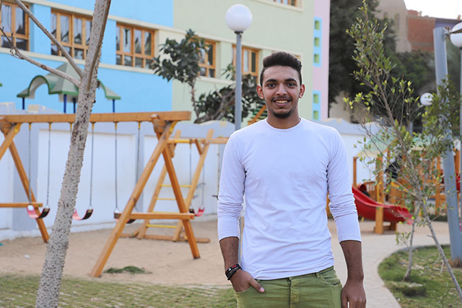 Mohamed Khamis, a volunteer for the Ending Violence against Women programme, poses for a picture in Imbaba.