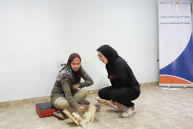 Heba breaking a piece of wood during the self-defense training.