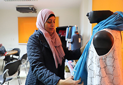 Fawzeya Ashraf adorns a mannequin with one of her creations.