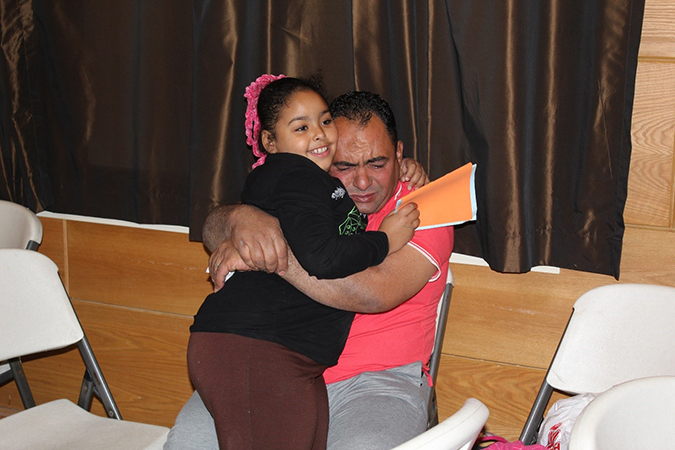 Mohamed Sayed hugs his daughter Nour with tears in his eyes during the Father and Child Camp.