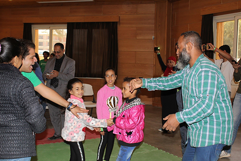 Araby Abdel-Aaty (right) dances with his daughters during the Father and Child Camp.