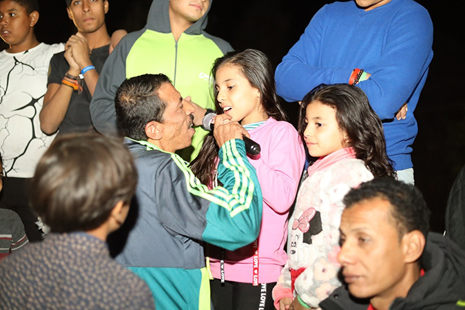 Hany sings with his daughters during the Father and Child Camp.