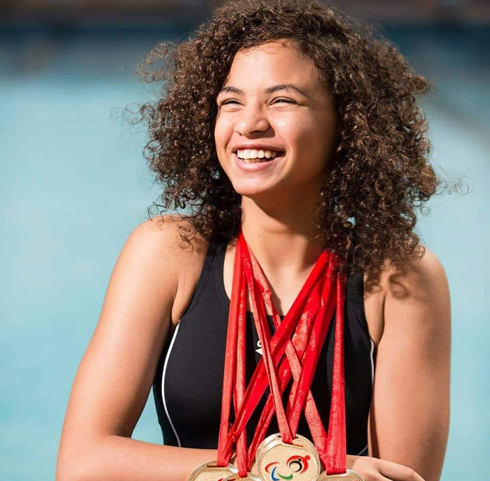 Malak Abdelshafi, Egyptian Champion in Paralympic Swimming, donning some of her medals. Photo: Courtesy of Malak Abdelshafi