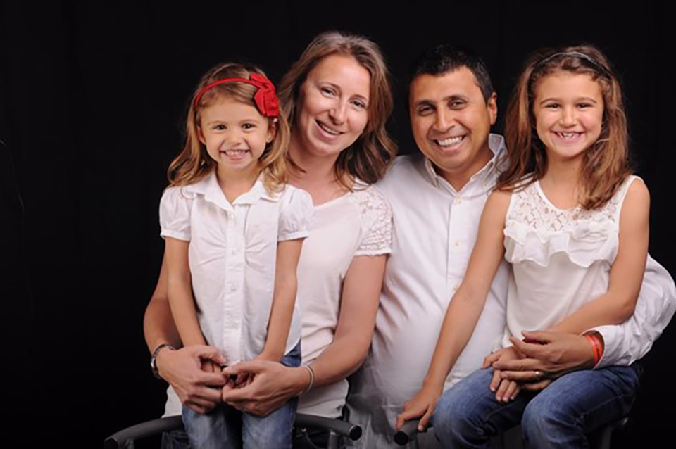 Maged Fawzy posing for a family photo with his wife and two daughters. Photo: Courtesy of Maged Fawzy