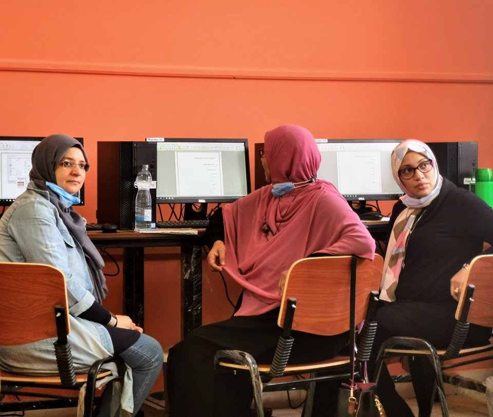 Marwa Saber (right) attends the IT training at Electro Misr Applied Technology School. Photo: Courtesy of IECD.
