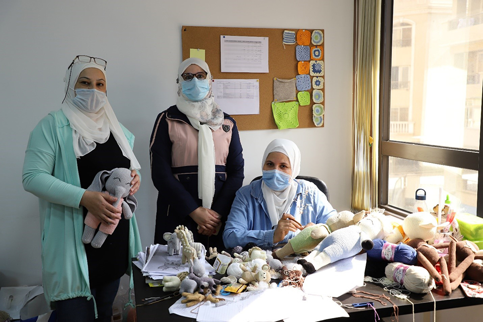 ElShalaby (in the middle) inside Vandi's office along with her colleagues. Photo: UN Women/Mohamed AbdelHameed