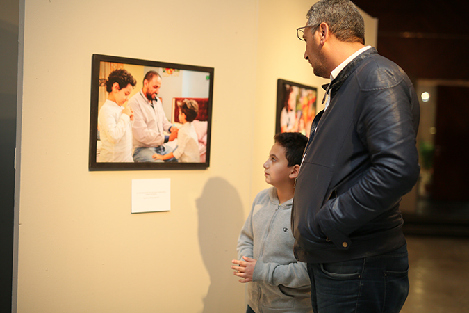 A Father and his Son During the Photo Exhibit