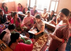 Conflict affected women and girls in discussion with facilitator