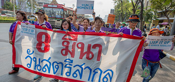 Women in Bangkok march for women's rights during the International Women's day. Photo: UN Women/Niels den Hollander