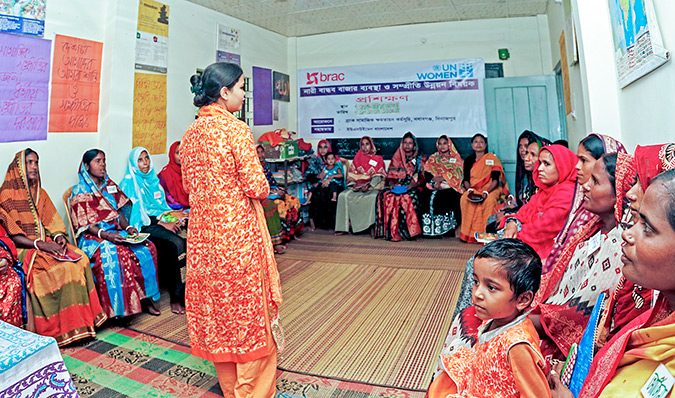 """""""Polli Shomaj Women"""" [community-based women's group] assembled to discuss how to prevent violent extremism in their own communities. Photo: UN Women/Snigdha Zaman"""