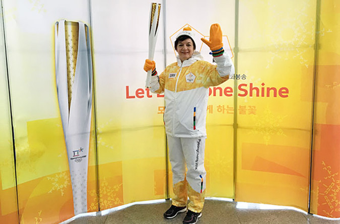UN Women Country Programme Manager in China Julie Broussard holds the Olympic Torch in Paju, South Korea