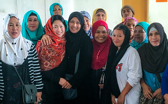 UN Women's Regional Director with women displaced by the Marawi siege in Balo-i. They are eager to build their economic empowerment and rebuild secure lives for their families. Photo: UN Women/Carla Silbert