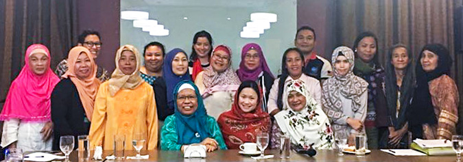 With women leaders from Mindanao who are at the frontlines of preventing violent extremism within their communities. Photo: UN Women/Malberry Suites