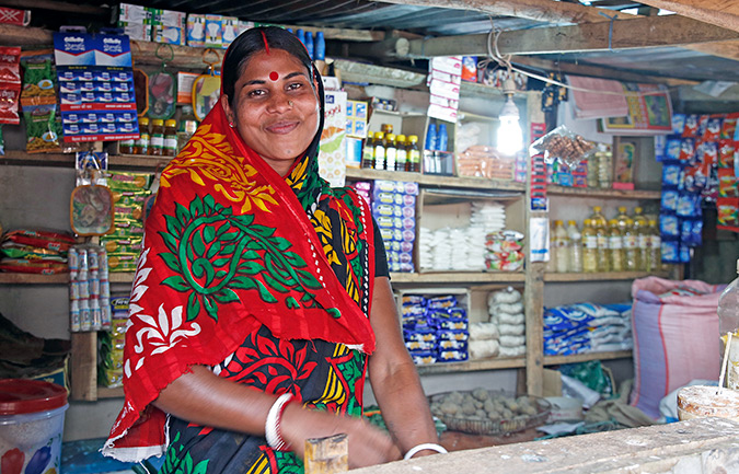 Sita Rani with her grocery shop in Rajnagar, eastern Bangladesh. Photo: UN Women/Asma Afrin Haque