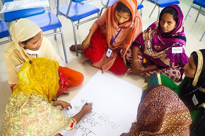 The garment factory workers do a group activity in the training given by UN Women and CARE to improve their lives. Photo: CARE/Kazi Mirzan