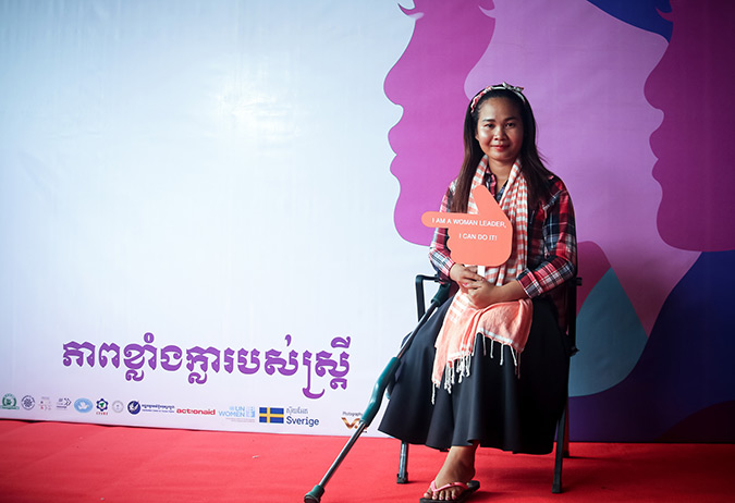 """Ms. Sor San, businesswoman joint the International Women's Day in Cambodia with the message: """"Being a woman with disability is my pride. I am a woman and was born with a disability, but I engage and participate a lot in the society which makes me brave and makes me feel that I am not lonely.""""  Photo: UN Women/Sreynich Leng"""