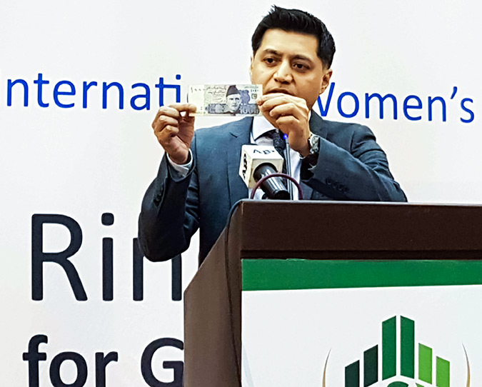Jamshed Kazi, Country Representative of UN Women Pakistan, speaks at the Ring the Bell Ceremony. It's time we put a picture of a woman on the rupee note, he said. Photo: UN Women/Faria Salman