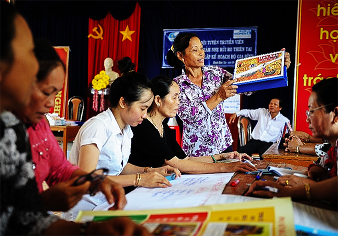 Local women's groups in Ca Mau, Viet Nam, in a group meeting on disaster management. Photo: UN Women Viet Nam