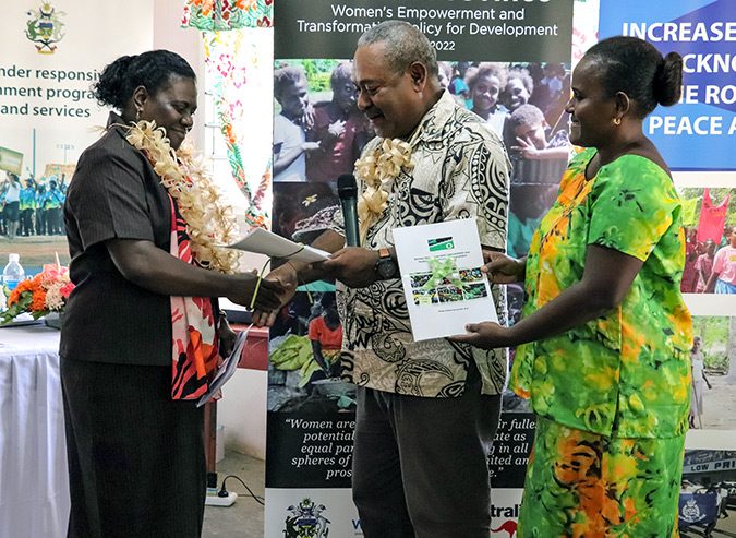 Western Province Minister of Women, Youth and Sports receives the first-ever women's policy from Provincial Secretary Jeffery Wickham and Women's Desk Officer Lisi Wong in Gizo on 18 July 2018. Photo: UNDP/Merinda Valley