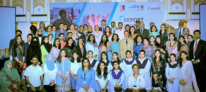 Guests at the 19 July report launch pose with UN Women's team. Photo: UN Women/Raza Saeed