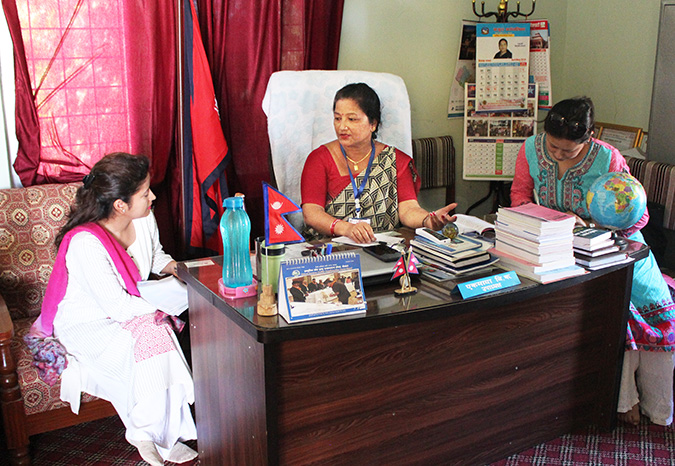 Ek Maya B.K., centre, Vice Chair of Khajura Rural Municipality in Banke, Nepal, meets with UN Women officials in her office on 28 June 2018. During the discussion, she highlighted the challenges and opportunities of women in leadership positions in Nepal. Photo: SABAH/Ayush Chaudhary