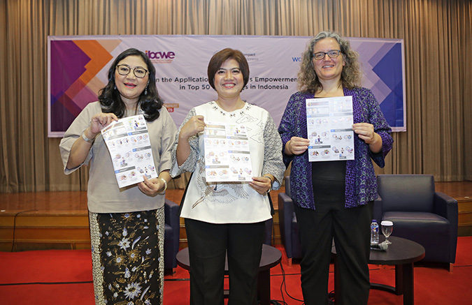 (Right to left) Josephine Satyono, Executive Director IGCN; Maya Juwita, Executive Director IBCWE; Sabine Machl, UN Women Representative, hold a copy of the infographics of the study findings at the WEPs study launch held on 29 August 2018. Photo: UN Women Indonesia/Iwan Kurniawan