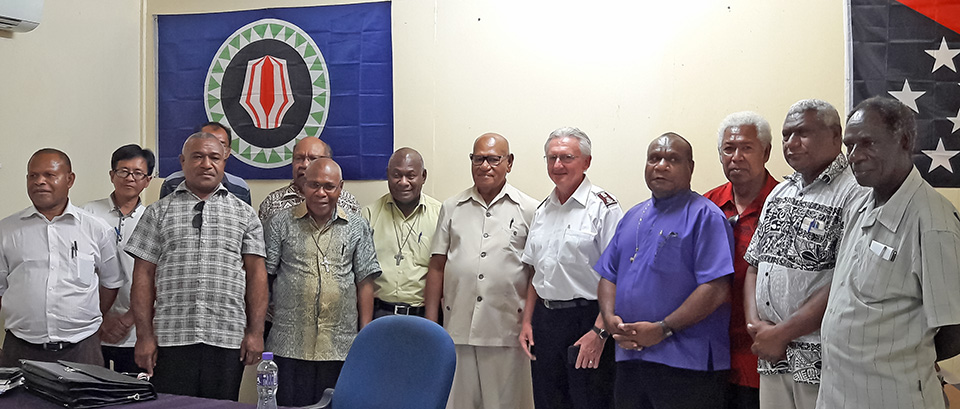 The President of the Autonomous Bougainville Government, John Momis, sixth from right, poses with members of the PNG Council of Churches on 24 August in Buka. They discussed how the churches can help keep Bougainville's upcoming referendum violence-free. Photo: UN Women/June Su