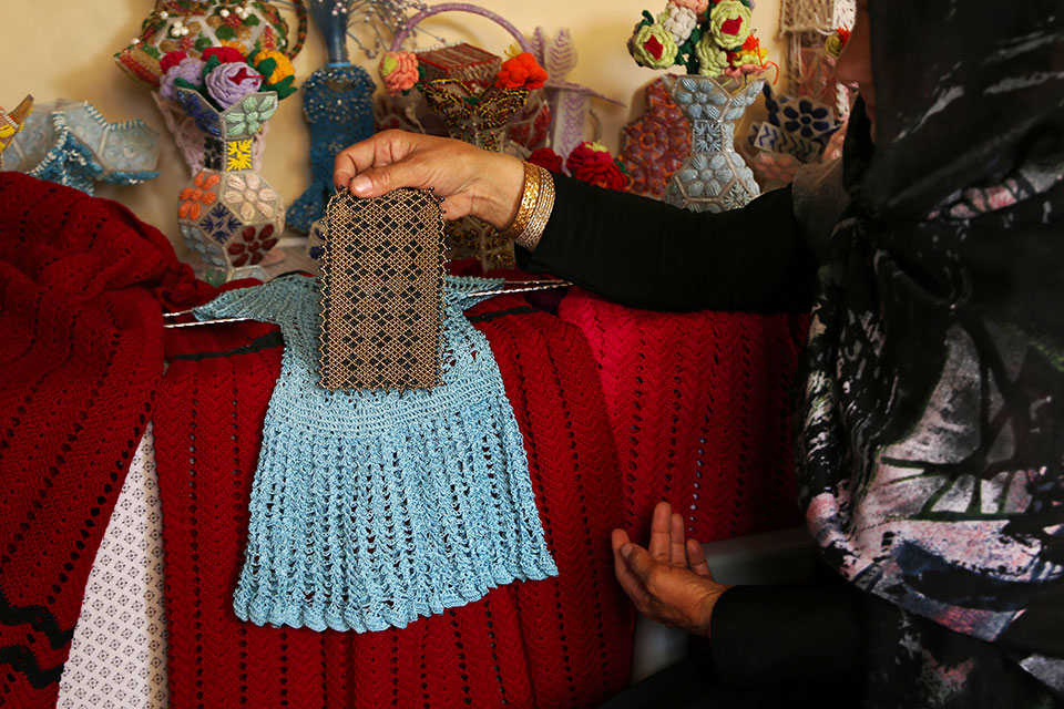 The Women's Protection Centre teaches women like Tabasum Bahar how to create beautiful works of art such as elegant clothes and embroidered scarves that guarantee income . Photo: UN Women/Zahra Khudadadi