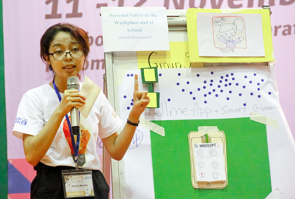 Montha Kanika, a student, talks about her team's prototype solution to sexual harassment at the innovation workshop on 12 November. Photo: UN Women/Leng Sreynich