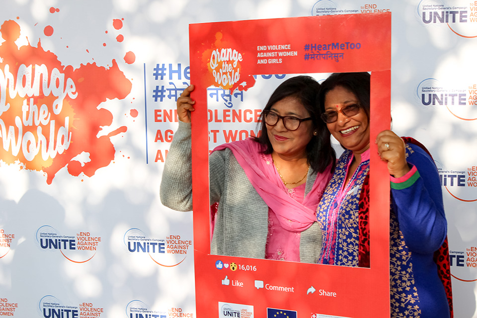 Participants at Province 7 take pictures with the #HearMeToo frames. Photo: UN Women/Anders Magnusson