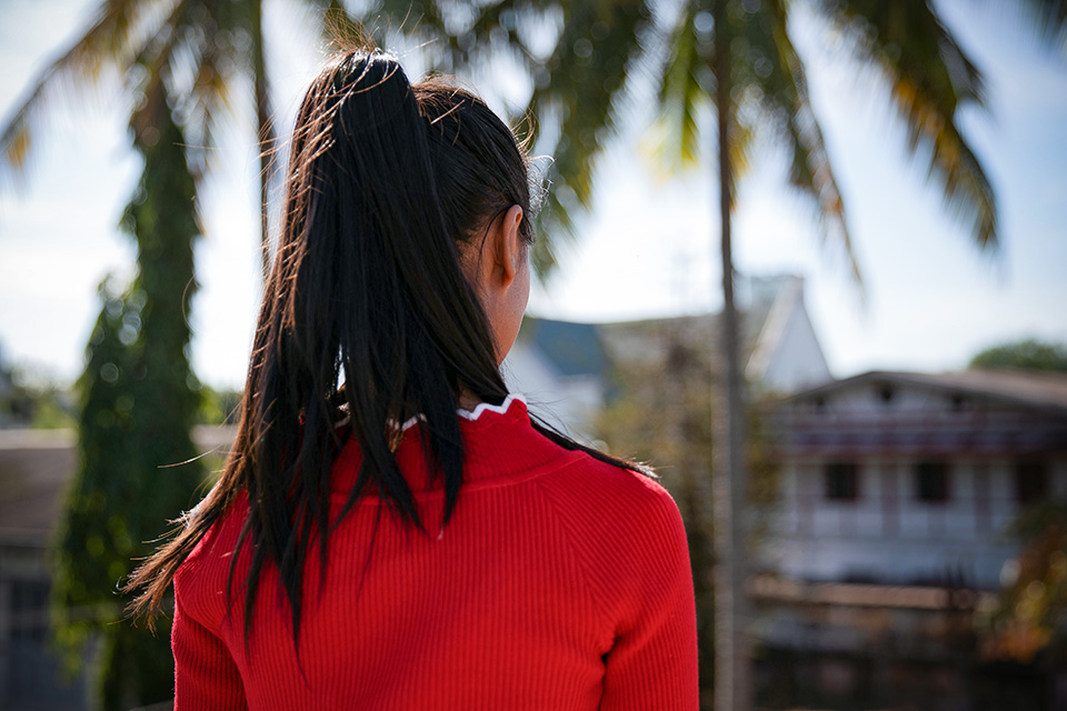 Aung Ja* was 18 when a woman from Myitkina, northern Myanmar, convinced her to take a 'factory' job in China. She was rescued in 2017 and is taking part in a UN Women-supported trafficking prevention programme. Photo: UN Women/Stuart Mannion