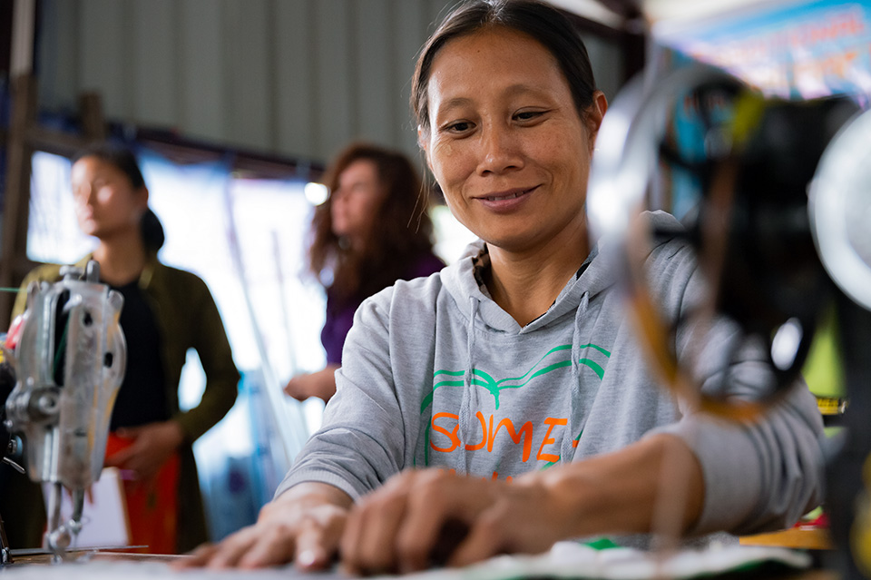 Khawng Tse, a 35-year-old internally displaced person (IDP) from Ayeyar Ward in the city of Myitkyina, Khawng Tse is completing her sewing classes and will receive a sewing machine from Htoi, with the support of UN Women. She hopes to set up her own tailoring business. Photo: UN Women/Stuart Mannion