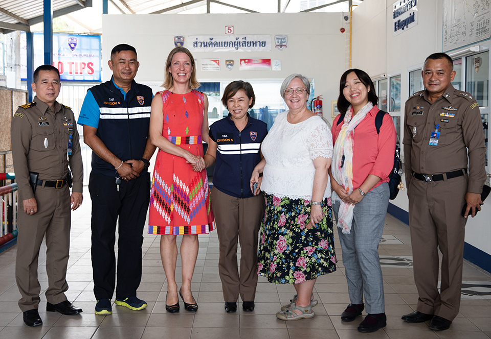 Immigration and border officials in Mae Sot, Thailand provide a tour of facilities to Anna Karin Jatfors, UN Women Asia Pacific Regional Director, a.i. (third from left); HE Donica Pottie, Canadian Ambassador to Thailand (third from right); and Ms. Mami Ueno, First Secretary, Japanese Embassy to Thailand (second from right). Photo: UN Women/Stephanie Simcox