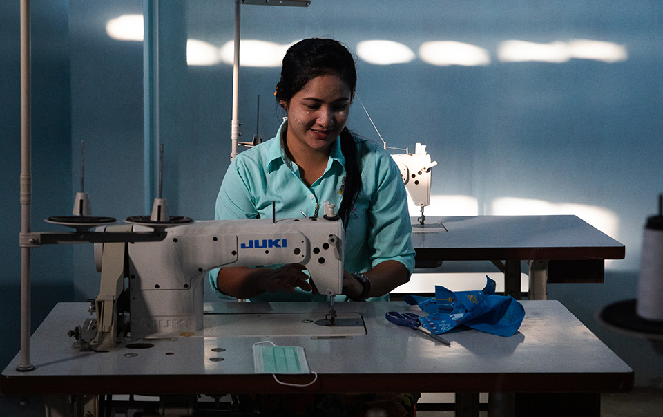 A Muslim migrant woman from Myanmar, pictured at the Islamic Community Center in Mae Sot, Thailand, where she studies sewing skills and learns about the difference between safe and unsafe migration. Photo: UN Women/Stephanie Simcox