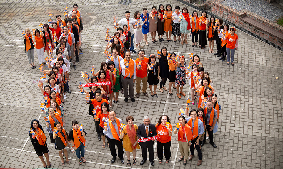 UN leaders and staff united in orange to show their commitment to increasing efforts to end violence against women and girls. Photo: UN Women/Doan Thanh Ha