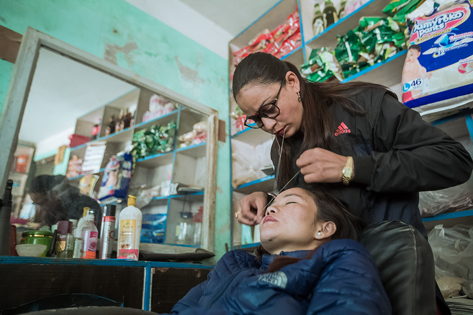 Sulochana Timalsina is the go-to person in her community. Women come to her for beauty treatments like eyebrow threading or hairdressing, as well as for advice on self-growth and empowerment. Photo: UN Women/Merit Maharjan