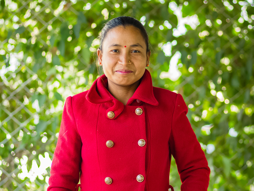 Padma Chaudhary is one of the successful e-rickshaw drivers in Dhangadhi who completed her driving training in Pourakhi Nepal's women empowerment initiative for returnee migrant workers. Photo: UN Women/Merit Maharjan