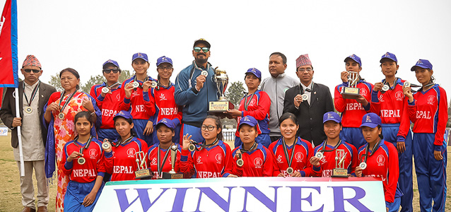 Team Captain Bhagwati Bhattarai-Baral (centre), holds the winning trophy as the team celebrates its victory at the First International Women's Blind Cricket Series. Photo: UNDP/Asfar Hussain Shah