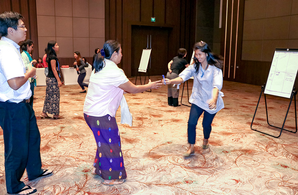 A Gender Relay Race, where three teams competed to write gender or sex attributes they think relate to men or women, was one of the activities at the Gender in Humanitarian Action Training-of-Trainers Workshop. Photo: UN Women/Cecilia Truffer